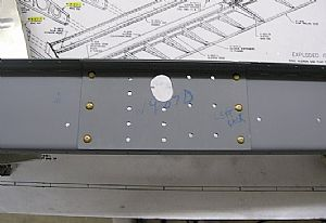 Riveted the W-907D doubler plate to the spar