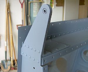 Riveted on the Aileron Brackets