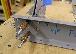 Starting riveting the nose rib/hinge assemblies to the left FL-903 Spar